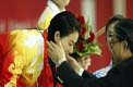 美联社:北京奥运东道主中国坐定头把交椅
